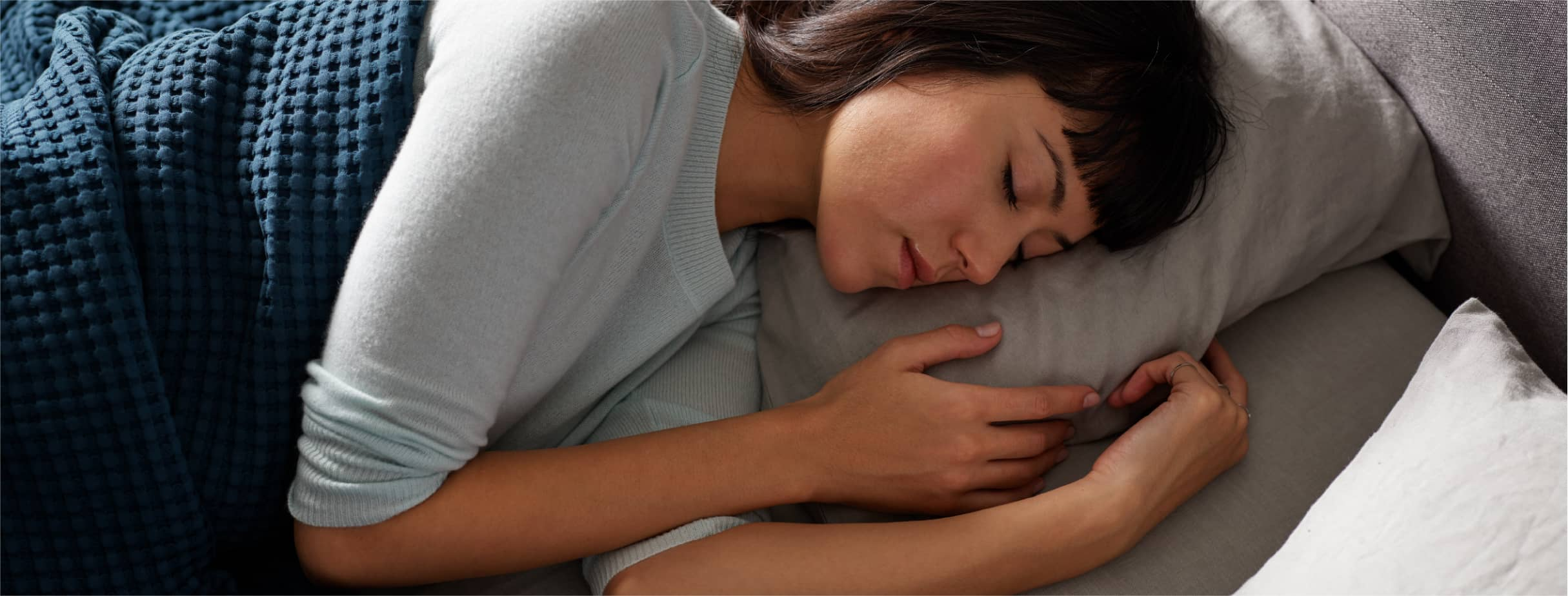 Woman sleeping on a Tempur-Pedic® mattress